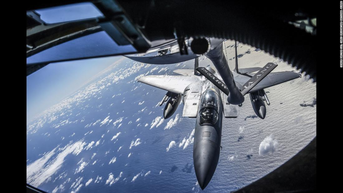 A California Air National Guard F-15 Eagle aircraft approaches the boom of an Iowa Air National Guard KC-135 Stratotanker above Joint Base Pearl Harbor-Hickam during an exercise in Hawaii on Wednesday, January 17.