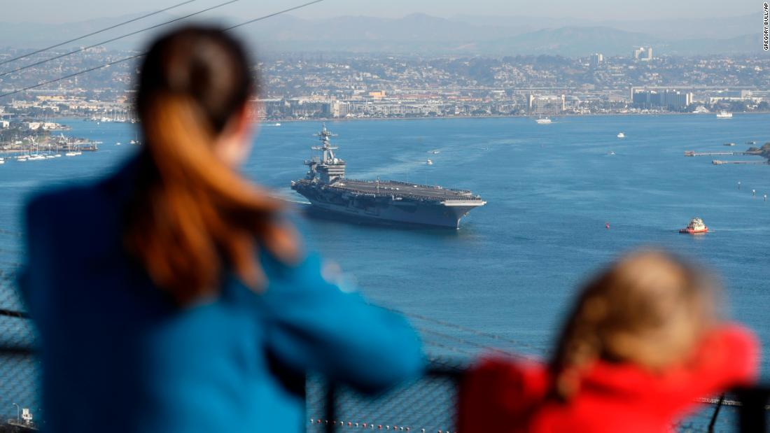 Leilani Duboise and her daughter, Mikayla Duboise, look on as the nuclear-powered USS Carl Vinson aircraft carrier leaves San Diego Bay for deployment to the western Pacific on Friday, January 5. Leilani's husband, Navy Chief Petty Officer Max Duboise, was aboard the USS Carl Vinson, along with more than 6,000 sailors, as part of a regularly scheduled deployment.