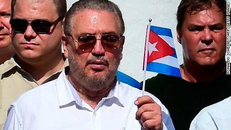 Fidel Castro Diaz-Balart holds the Cuban flag in 2016.