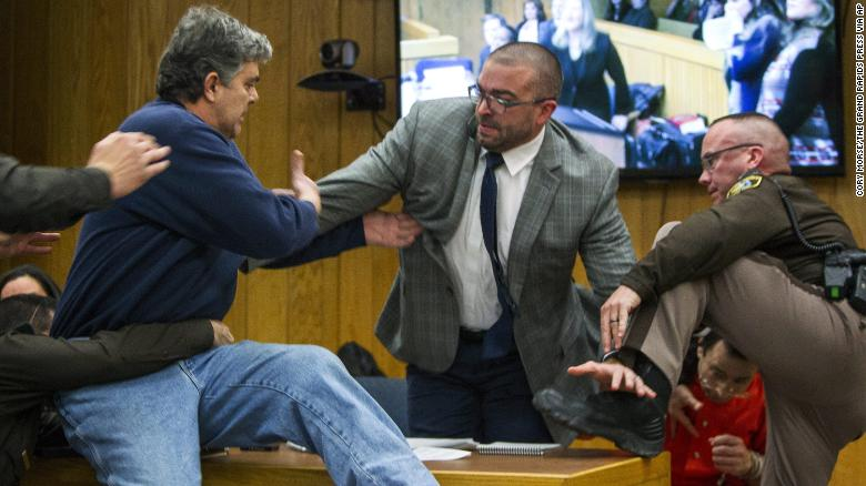 Randall Margraves, father of three victims of Larry Nassar, lunged at Nassar, bottom right, on Friday in Eaton County Circuit Court in Michigan.