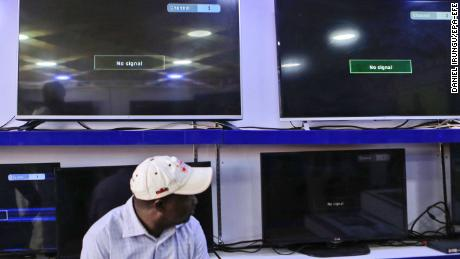 epa06489825 A Kenyan man sits in front of black screens showing a 'No Signal' message on what is supposed to be three of Kenya's local TV channels taken off air, at an electronics shop in Nairobi, Kenya, 01 February 2018. Kenya's three private TV stations -- NTV, KTN and Citizen TV -- reportedly were taken off air on 31 January following their live coverage of the opposition?s ceremony to 'swear-in' their leader Raila Odinga who lost a disputed presidential election in late 2017. Interior minister Fred Matiangi said the broadcasters will remain shut until the investigations into their links with opposition is completed. The country's High Court on 01 February suspended the shutdown for 14 days until the case is determined, local media reported. Kenyan media industry has denounced the move, terming it 'unprecedented'.  EPA-EFE/DANIEL IRUNGU