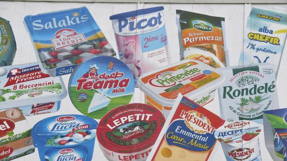 A picture taken on January 12, 2018 shows products painted on a wall of the headquarters of French dairy group Lactalis.