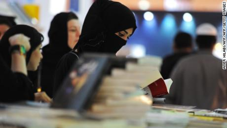 A Saudi woman looks at a book during the International Jeddah Book Fair on December 16, 2017.  / AFP PHOTO / Amer HILABIAMER HILABI/AFP/Getty Images