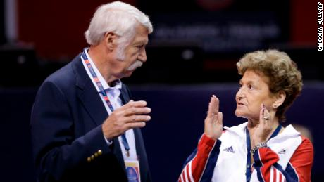 Husband and wife Bela and Martha Karolyi talk before the US women's Olympic gymnastics trials in 2012.