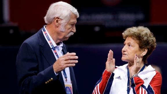 Husband and wife Bela and Martha Karolyi talk before the US women