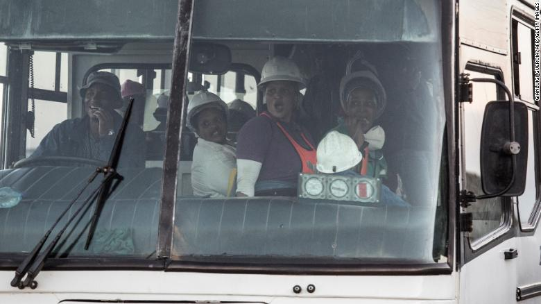 A bus transports some of the hundreds of miners rescued from the Beatrix gold mine shaft number 3 in Theunissen on February 2, 2018.