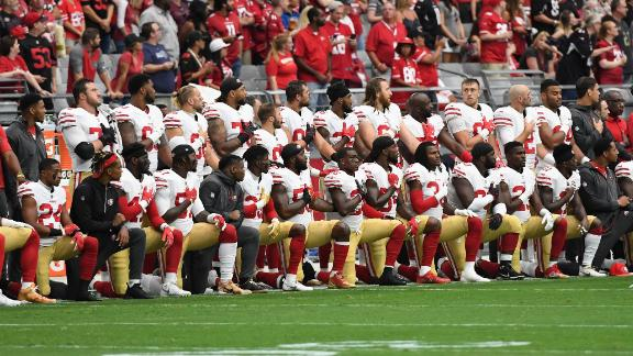 Members of the San Francisco 49ers kneel during the National Anthem ahead of their game against the Arizona Cardinals at the University of Phoenix Stadium in Glendale, Arizona. Former 49ers quarterback Colin Kaepernick sparked the anthem protest when he took a knee in September 2016 to call attention to racism and police brutality.