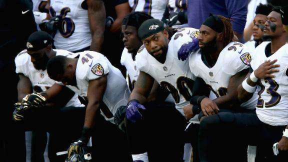 Baltimore Ravens players kneel during the National Anthem during the NFL International Series match against the Jacksonville Jaguars at Wembley Stadium in London.
