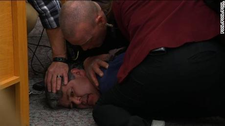 Randall Margraves, the father of three daughters who have been abused by Larry Nassar tried to attack the former doctor in Eaton County court Friday before he was tackled and arrested by security.