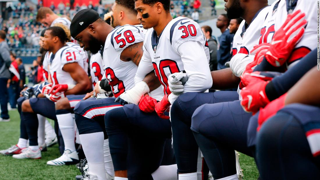 Members of the Houston Texans kneel during the National Anthem before the game at CenturyLink Field on October 29 in Seattle.