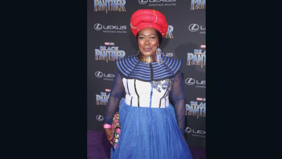 South African actor Connie Chiume, who plays the mining tribe elder in Wakanda, stuns in her native South African attire.<br /><br /><em>Black Panther opens in theaters on February 16, 2018.</em>