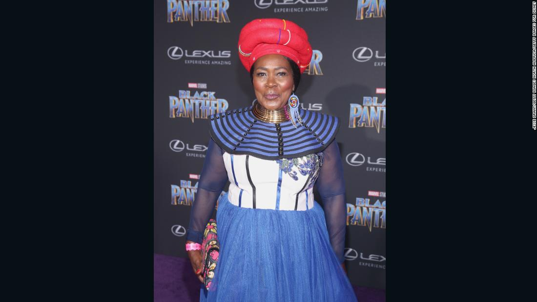 South African actor Connie Chiume, who plays the mining tribe elder in Wakanda, stuns in her native South African attire.<br /><em><br />Black Panther opens in theaters on February 16, 2018.</em>
