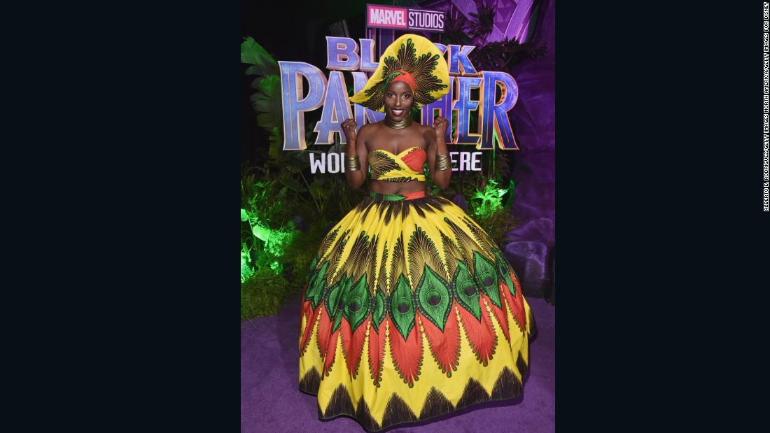 Actor Janeshia Adams-Ginyard is one of the Dora Milaje warriors of Wakanda. She looks radiant in full skirt and crop top made from multicolored Ankara, and with matching hat and head wrap Janeshia took the theme a step forward.