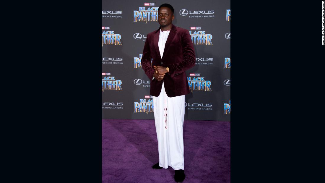 Daniel Kaluuya in maroon Burberry velvet blazer worn on a traditional Ugandan white kanzu.