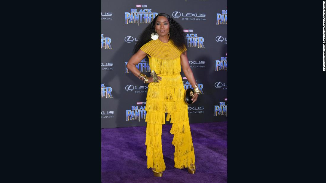 At 59, actor Angela Bassett looks beautiful as she rocks a classy neon-fringed Naeem Khan jumpsuit. Angela Bassett is T'Challa's mother Ramonda in Black Panther.