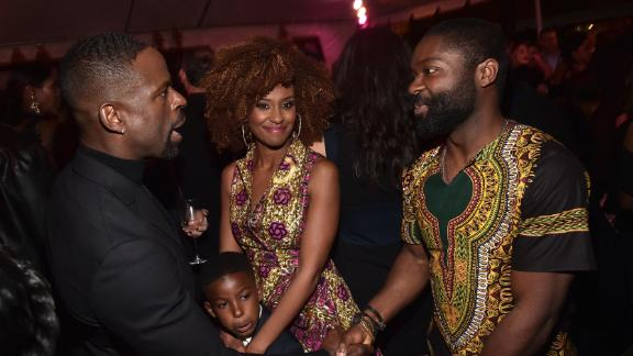 (L-R) Golden Globe winner Sterling K. Brown and his wife Ryan Michelle Bathe and son Andrew Brown with actor David Oyelowo in detailed African prints.