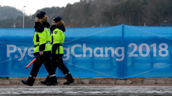 Security workers patrol the Alpensia resort at the 2018 Winter Olympics in Pyeongchang, South Korea, Friday, Feb. 2, 2018. (AP Photo/Charlie Riedel)