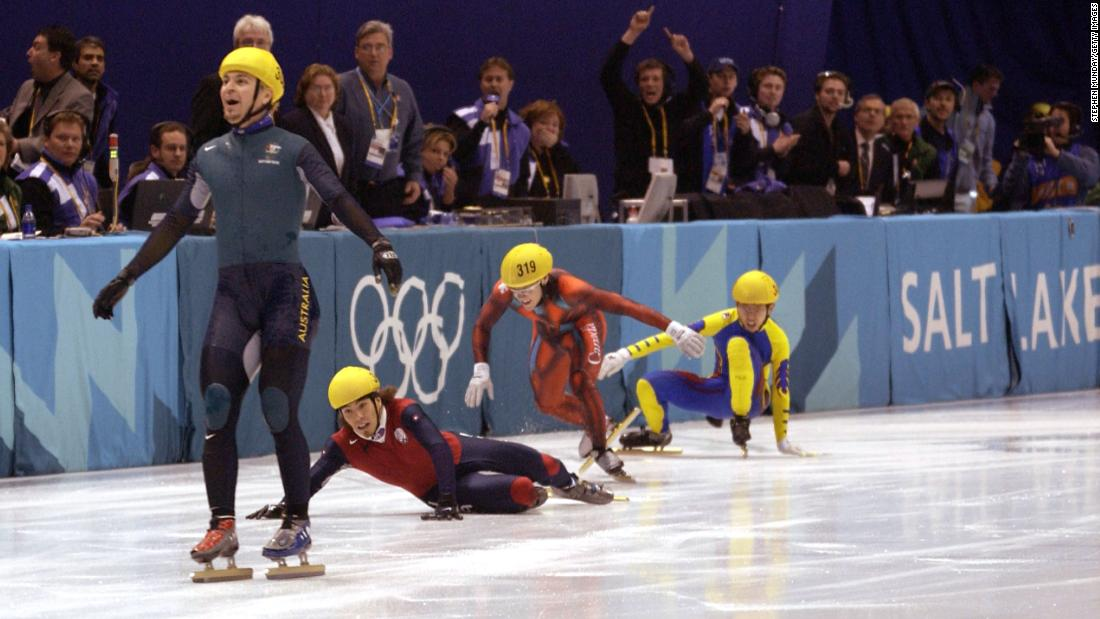 Australia's first ever Winter Gold medal winner Steven Bradbury crosses the line while America's Apolo Anton Ohno scrambles for the line to claim second place after the men's 1000m speed skating final during the Salt Lake City Winter Olympic Games in 1980.