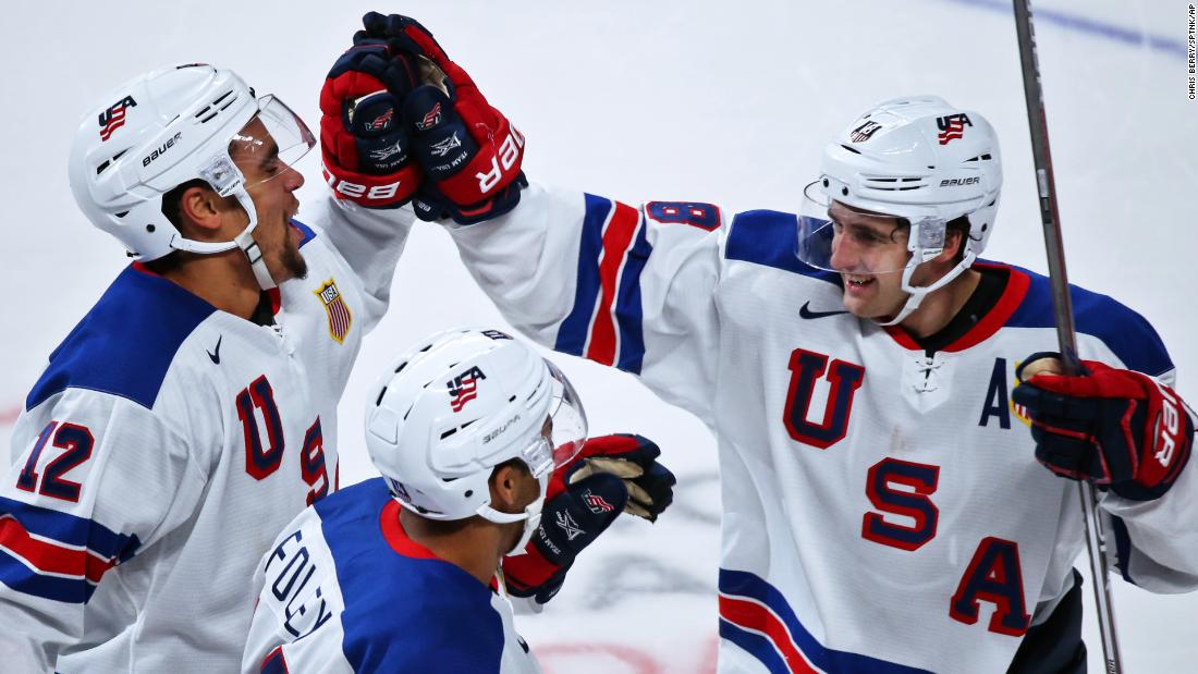US players Jordan Greenway, Eric Foley and Colin White celebrate winning in the IIHF World Junior Championship semifinals between the national teams of US and Russia.