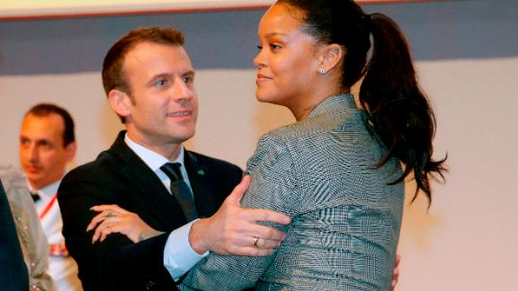"French President Emmanuel Macron embraces singer Rihanna as they attend the conference ""GPE Financing Conference, an Investment in the Future"" in Dakar on February 2, 2018, as part of Macron"