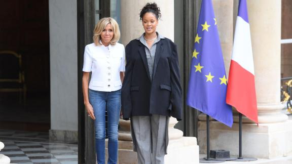 Brigitte Macron, wife of the French president, escorts Rihanna after a meeting with the French president at the Elysee Palace in Paris on July 26, 2017.