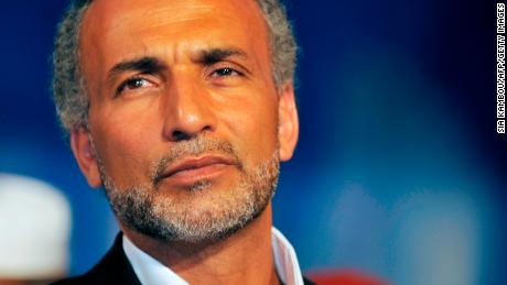"Swiss citizen of Egyptian origin Muslim intellectual and professor Tariq Ramadan gives a speech on August 26, 2011 at the Treichville sports parc, a popular district of Abijdan, during a conference ""Night Destiny (Muslim feast known as Laylat al-Qadr), Night of Peace and Reconciliation"". Laylat Al Qadr, the most important prayer of the fasting month, is the night Muslims commemorate the revelation of the first verses of the Quran to their prophet Mohammed through the angel Gabriel. Muslims spend the night in worship and devotion, praying for the souls of the dead."