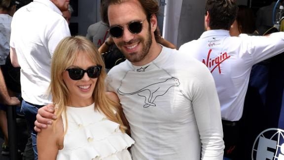 Pop singer Kylie Minogue shared a moment with Frenchman Jean-Eric Verge -- who races for Chinese team Techeetah --  ahead of his fourth round victory in Santiago, Chile on February 3, 2018.