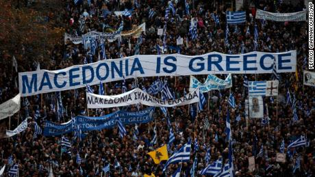 Protesters from across Greece converged Sunday on Athens' main square outside parliament to protest a potential Greek compromise in a dispute with neighboring Macedonia over the former Yugoslav republic's official name.