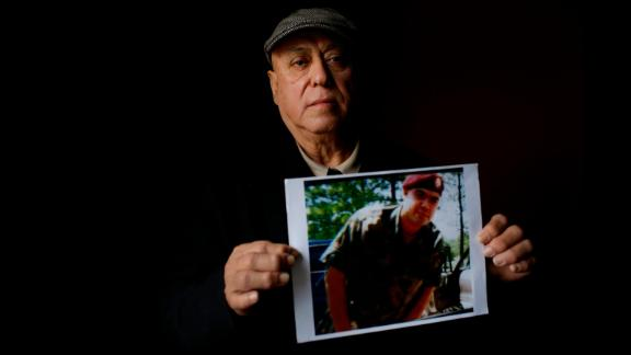 Miguel Perez Sr. holds a photo of his son, Miguel Perez Jr., on April 4 in Chicago.