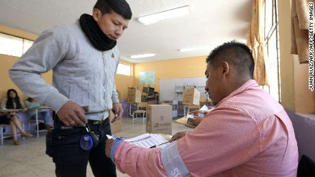 A young man casts his vote at a polling station in Quito during a referendum called by President Lenin Moreno on February 4, 2018. Ecuadoreans decide the political fate of former president Rafael Correa Sunday in a referendum called by his successor turned staunched opponent and expected to prevent him from returning to power. / AFP PHOTO / Juan RuizJUAN RUIZ/AFP/Getty Images