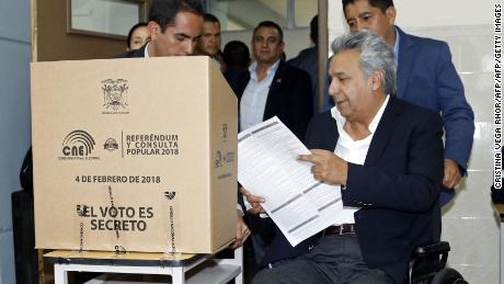 "CORRECTION - Ecuadorian President Lenin Moreno casts his vote at the Universidad Tecnológica Equinoccial"" during the Referendum election, in Quito, on February 4, 2018.  Ecuadoreans decide the political fate of former president Rafael Correa Sunday in a referendum called by his successor turned staunched opponent and expected to prevent him from returning to power.  / AFP PHOTO / Cristina Vega Rhor / The erroneous mention[s] appearing in the metadata of this photo by Cristina Vega Rhor has been modified in AFP systems in the following manner: [on February 4] instead of [on April 2]. Please immediately remove the erroneous mention[s] from all your online services and delete it (them) from your servers. If you have been authorized by AFP to distribute it (them) to third parties, please ensure that the same actions are carried out by them. Failure to promptly comply with these instructions will entail liability on your part for any continued or post notification usage. Therefore we thank you very much for all your attention and prompt action. We are sorry for the inconvenience this notification may cause and remain at your disposal for any further information you may require.CRISTINA VEGA RHOR/AFP/Getty Images"