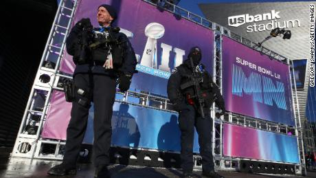 MINNEAPOLIS, MN - FEBRUARY 04: Police stand guard outside before the start of Super Bowl LII at U.S. Bank Stadium on February 4, 2018 in Minneapolis, Minnesota.