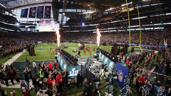 The Eagles take the field before the game.