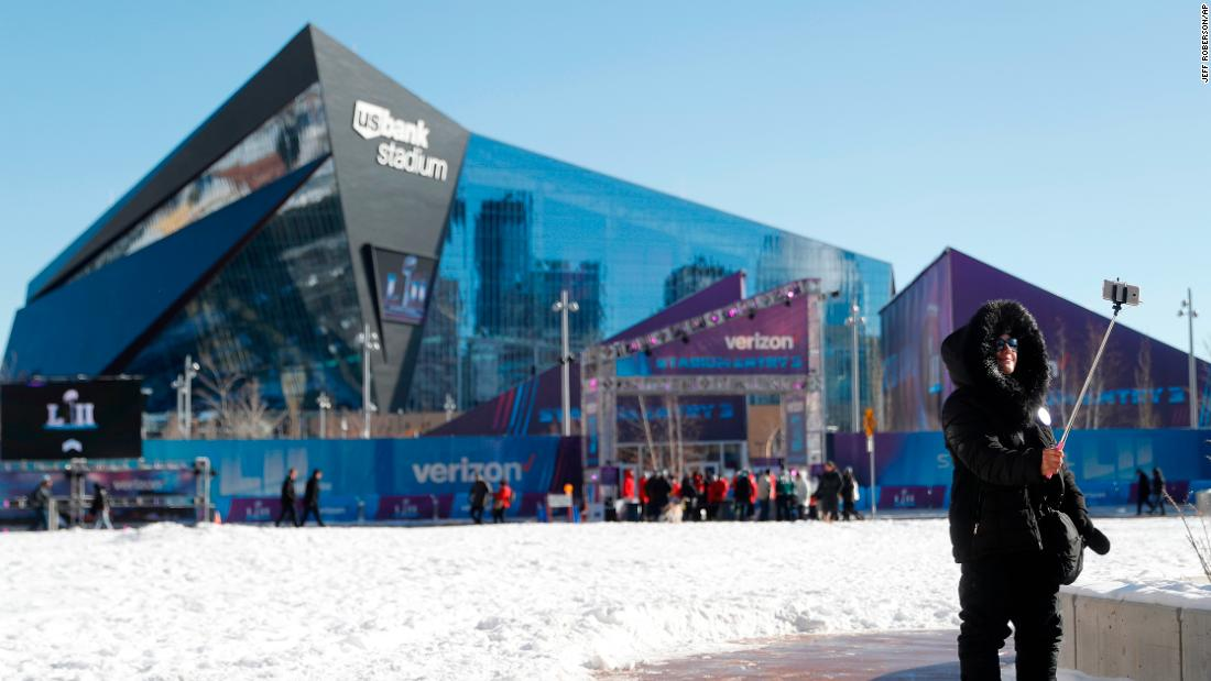 A fan takes a selfie outside US Bank Stadium before the game. The game is indoors, but outside it is the coldest Super Bowl on record.