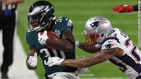 Philadelphia Eagles running back Corey Clement (30) carries the ball as New England Patriots strong safety Patrick Chung (23) and Patriots defensive back Brandon King (36) defend during the first quarter in Super Bowl LII at U.S. Bank Stadium. Mandatory Credit: John David Mercer-USA TODAY Sports