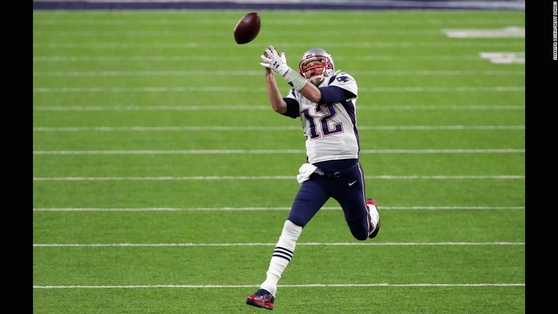 Brady drops a pass during a trick play in the second quarter.