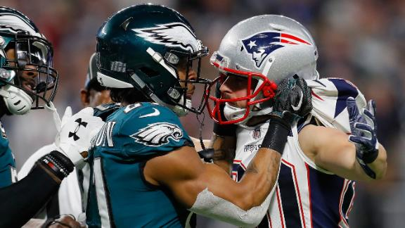 Amendola and Philadelphia's Patrick Robinson exchange words after a whistle.