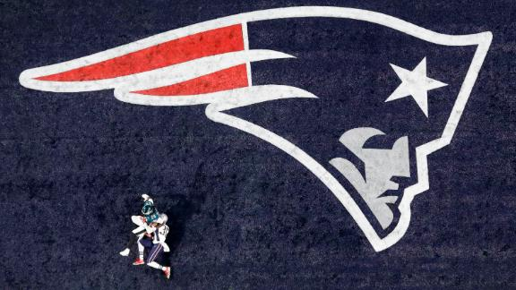 Blount falls into the end zone on his touchdown run. Blount won a Super Bowl with the Patriots last year.