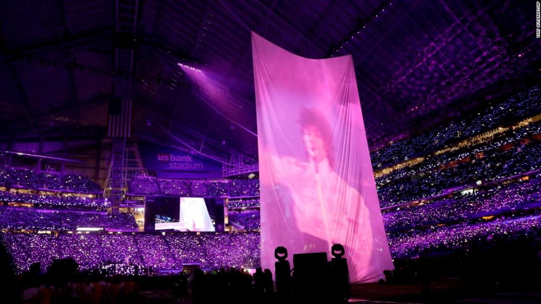 Video of the late singer Prince, a Minneapolis native, can be seen above the stage as Timberlake pays homage to him.