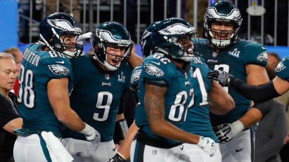 Foles is mobbed by teammates after his unlikely touchdown catch.
