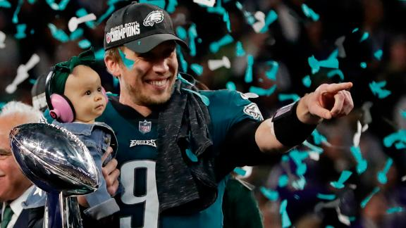 Philadelphia Eagles quarterback Nick Foles holds his daughter, Lily, after the Eagles won the Super Bowl on Sunday, February 4. Foles was named the most valuable player of the game, which the Eagles won 41-33 over the New England Patriots. It is the franchise