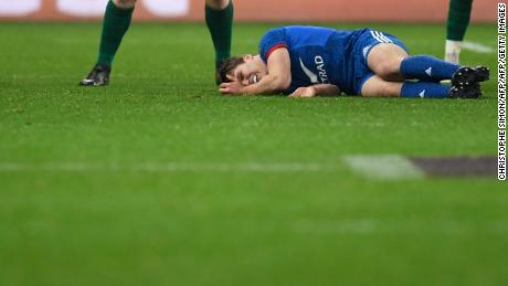 France's Antoine Dupont lies on the pitch after being injured during the Six Nations rugby union match between France and Ireland.