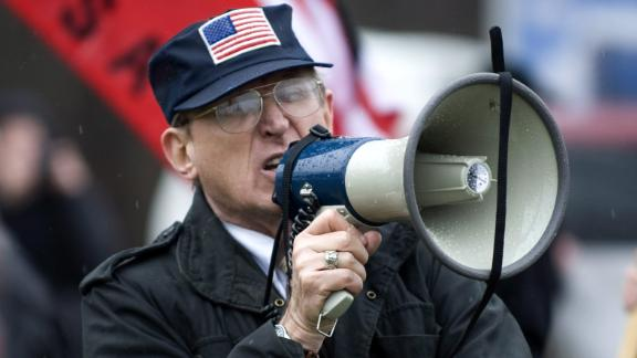 Arthur Jones shouts into a bullhorn during a protest at the dedication ceremony for the Illinois Holocaust Museum and Education Center in Skokie, Illinois, in April 2009.