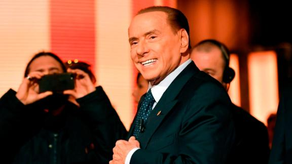 """Italian former Prime Minister and leader of center-right party Forza Italia (Go Italy), Silvio Berlusconi arrives to attend the TV show """"Quinta Colonna"""", a programme of Italian channel Rete 4, on January 18, 2018 in Rome. / AFP PHOTO / Andreas SOLARO        (Photo credit should read ANDREAS SOLARO/AFP/Getty Images)"""