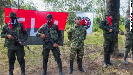 Colombian Soldier Fredy Moreno (C) who was kidnaped by National Liberation Army (ELN), is seen next to ELN members, before his release in Arauca, Colombia on February 6 2017.   Colombia's ELN rebels freed soldier Fredy Moreno Mahecha in a rural area of Arauca department, in a new goodwill gesture on the eve of peace talks to end a 53-year conflict, the Red Cross said.  / AFP / Daniel MARTINEZ        (Photo credit should read DANIEL MARTINEZ/AFP/Getty Images)