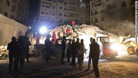 Syrian emergency services search for members of four families reportedly stuck under the rubble of a six story building that collapse following Syrian government air strikes on Idlib on February 4, 2018.    / AFP PHOTO / OMAR HAJ KADOUR        (Photo credit should read OMAR HAJ KADOUR/AFP/Getty Images)