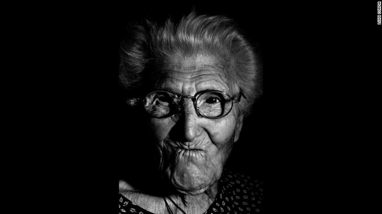 Maria Bonaria Argiolas, born in 1909, prays every day and enjoys watching the news on TV.