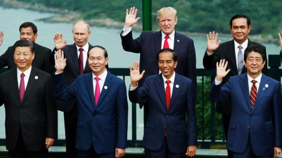 "(Front L to R) China's President Xi Jinping, Vietnam's President Tran Dai Quang, Indonesia's President Joko Widodo, Japan's Prime Minister Shinzo Abe, (back L to R) Philippine President Rodrigo Duterte, Russia's President Vladimir Putin, US President Donald Trump, and Thailand's Prime Minister Prayut Chan-O-Cha pose during the ""family photo"" during the Asia-Pacific Economic Cooperation (APEC) leaders' summit in the central Vietnamese city of Danang on November 11, 2017. World leaders and senior business figures are gathering in the Vietnamese city of Danang this week for the annual 21-member APEC summit. / AFP PHOTO / POOL / JORGE SILVA        (Photo credit should read JORGE SILVA/AFP/Getty Images)"