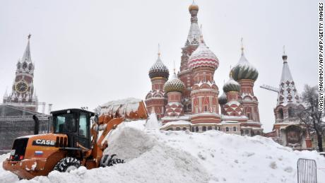 TOPSHOT - A bulldozer shovels snow off Red Square as snow falls in Moscow on February 4, 2018.   / AFP PHOTO / Vasily MAXIMOVVASILY MAXIMOV/AFP/Getty Images