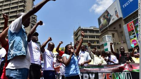 Activists demonstrate in the streets of Nairobi on Monday against the shutdown of several TV channels over their opposition coverage.